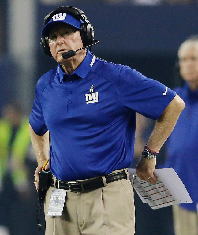 . New York Giants head coach Tom Coughlin watches action against the Dallas Cowboys during the first half of an NFL football game, Sunday, Sept. 8, 2013, in Arlington, Texas. (AP Photo/LM Otero)