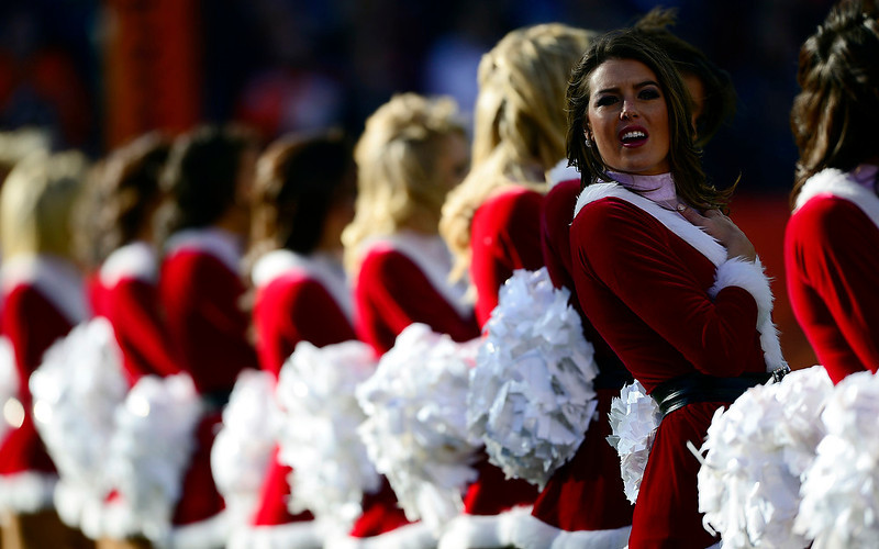 . Dressed for the holidays the Broncos cheerleaders sing the National Anthem prior to the game.  The Denver Broncos vs Cleveland Browns at Sports Authority Field Sunday December 23, 2012. AAron Ontiveroz, The Denver Post