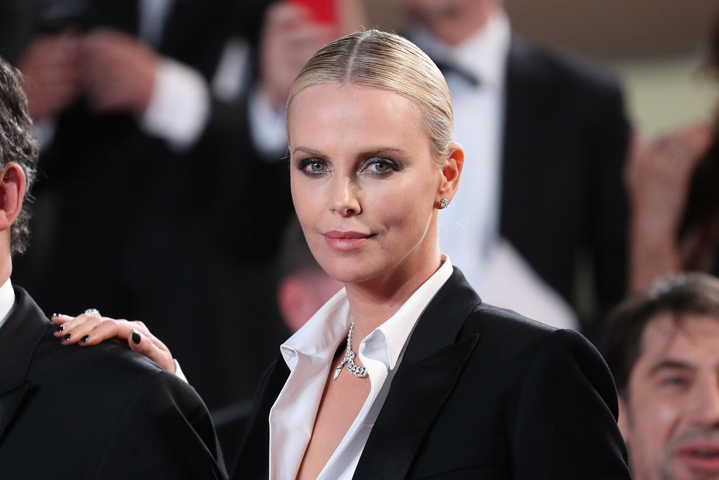 ". Actress Charlize Theron leaves  ""The Last Face\"" Premiere during the 69th annual Cannes Film Festival at the Palais des Festivals on May 20, 2016 in Cannes, France.  (Photo by Andreas Rentz/Getty Images)"