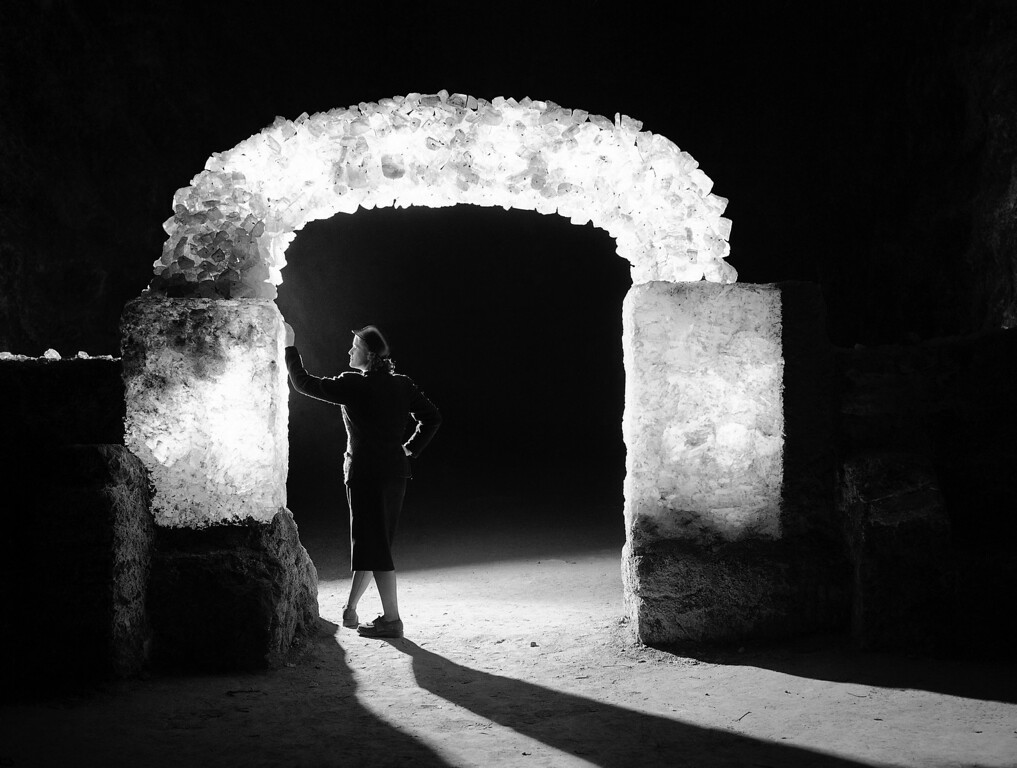 . Attractive arch was built of salt crystals with electric lights concealed inside. It is part of the display in the salt mine, which is visited by thousands of sightseers every Sunday at Kochendorf, Germany, Jan. 20, 1950. (AP Photo/Albert Riethausen)