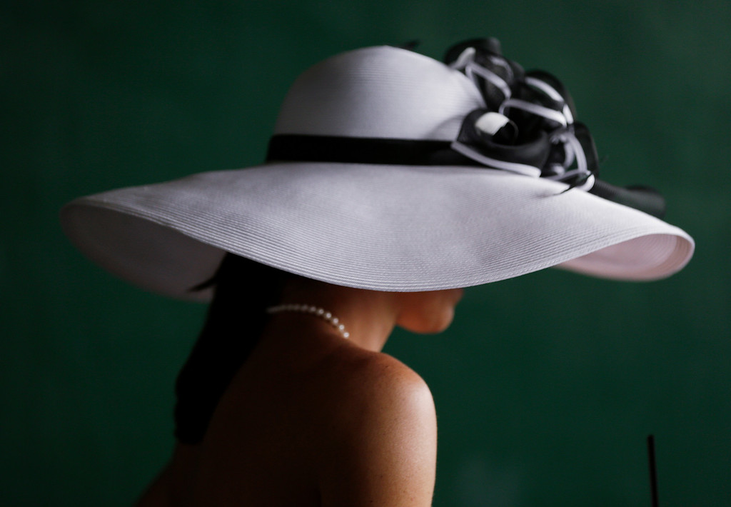 . A fan wears a hat before the 142nd running of the Kentucky Derby horse race at Churchill Downs Saturday, May 7, 2016, in Louisville, Ky. (AP Photo/David J. Phillip)