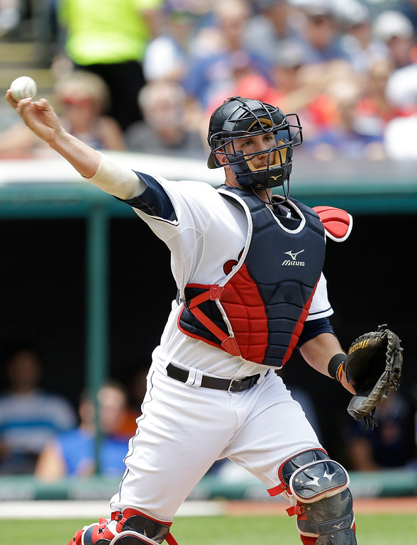 . Cleveland Indians catcher Yan Gomes throws out Detroit Tigers\' Bryan Holaday at first base in the third inning of a baseball game, Wednesday, June 24, 2015, in Cleveland. (AP Photo/Tony Dejak)