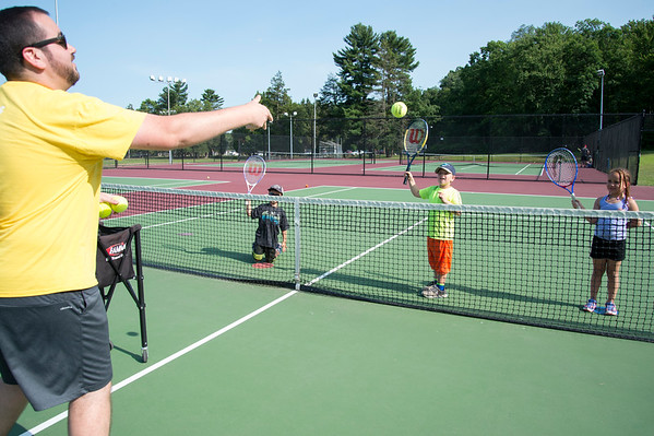 07/08/19 Wesley Bunnell | Staff The Bristol Parks & Recreation department is holding tennis lessons for children ages 4-7 every Monday and Wednesday afternoon through the first week of August at Page Park. Instructor John Anastasio performs a drill students including Antonio Chatfield, L age 6 and Nathaniel Helming, age 7.