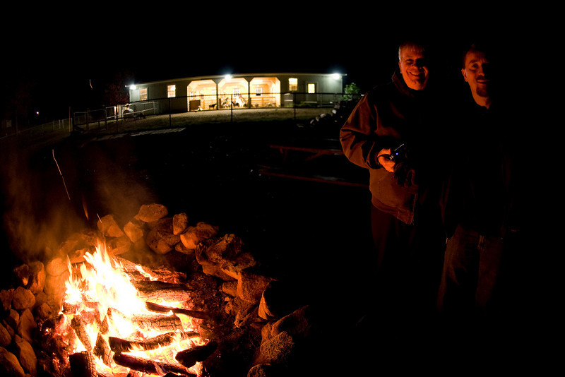 The Glenns and I are waiting for the next wagon at Charmingfare. The bonfire is nice and warm. The barn behind us is filled with goats and has piped spooky sounds emanating from within. We wonder if the goats react to the sounds like we do.