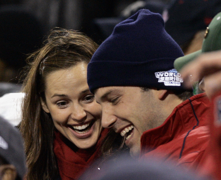 . Actors Jennifer Garner, left, and Ben Affleck are shown during Game 1 of the World Series in Boston, Saturday, Oct. 23, 2004.  (AP Photo/Elise Amendola)