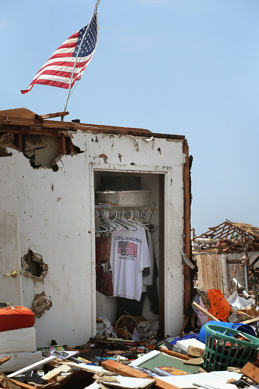 . MOORE, OK - MAY 23:  An Oklahoma T-shirt hangs in the closet of a home that was destroyed by a tornado, on May 23, 2013 in Moore, Oklahoma. A two-mile wide EF5 tornado touched down in Moore May 20 killing at least 24 people and leaving behind extensive damage to homes and businesses. U.S. President Barack Obama promised federal aid to supplement state and local recovery efforts.  (Photo by Scott Olson/Getty Images)