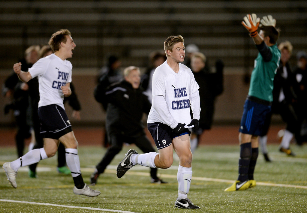 . Sam Stark of Pine Creek High School (9) and teammates celebrate their win in the 5A boy\'s soccer semifinal game against Boulder High School at Legacy Stadium in Aurora, Colorado, on Wednesday, November 6, 2013. Pine Creek won 1-0 in overtime. (Photo by Hyoung Chang/The Denver Post)
