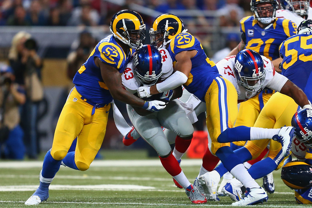 . ST. LOUIS, MO - DECEMBER 21: Orleans Darkwa #43 of the New York Giants is tackled by Alec Ogletree #52 and T.J. McDonald #25 of the St. Louis Rams during the second quarter at the Edward Jones Dome on December 21, 2014 in St. Louis, Missouri.  (Photo by Dilip Vishwanat/Getty Images)