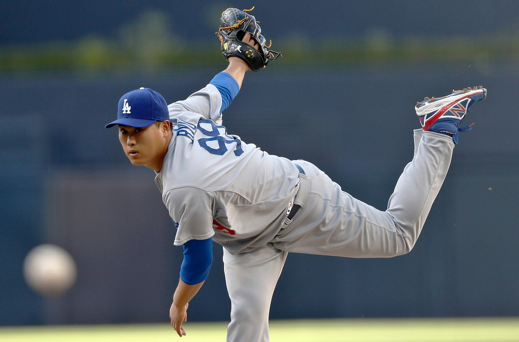 . Los Angeles Dodgers starting pitcher Hyun-Jin Ryu works against the San Diego Padres in the first inning of the opening game of Major League baseball in the United States Sunday, March 30, 2014, in San Diego.  (AP Photo/Lenny Ignelzi)