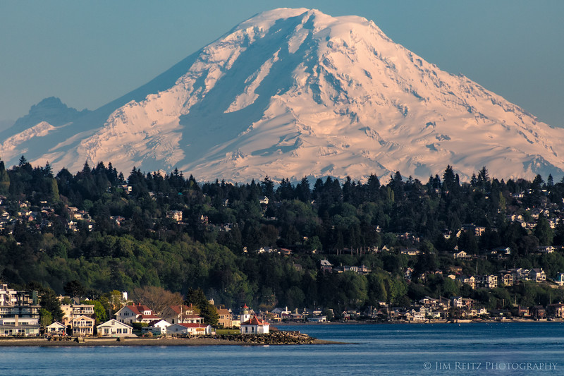 Seattle's cute little Alki Point Lighthouse, with Mount Rainier towering in the background 60 miles away.