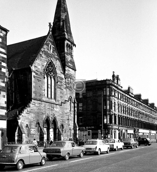Eglinton St, east side at Devon St. In January 2000, after celebrating its year as European City of Architecture and Design, 1999, Glasgow ruthlessly destroyed one of Burnet's few remaining churches, the French Gothic Eglinton Congregational Church, 341 Eglinton Street, which included the destruction of pairs of fine Mossman angels and dragon gargoyles (1866). [Glasgow - City of Sculpture]June 1975