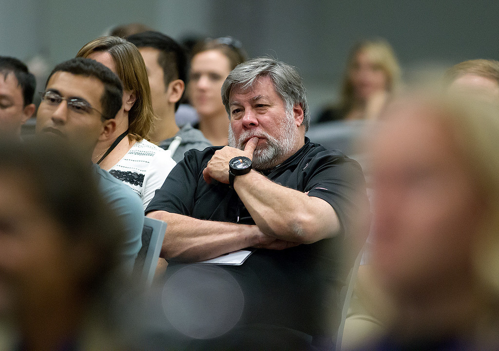 . Steve Wozniak, co-founder of Apple Computer, listens to John McAfee speak during the C2SV Technology Conference + Music Festival at the McEnery Convention Center in San Jose, Calif., on Saturday, Sept. 28, 2013.   (LiPo Ching/Bay Area News Group)