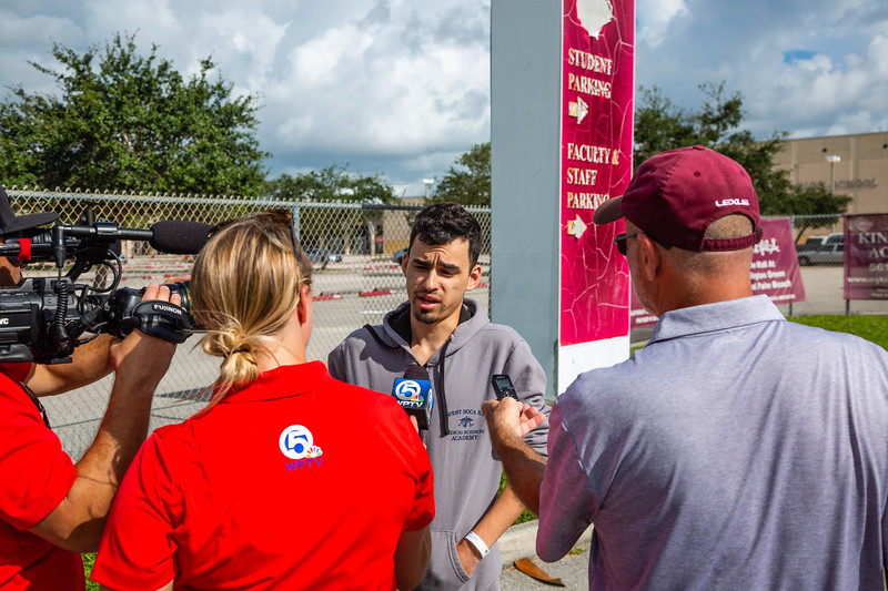 Eduardo Estella, 21, an employee of Rita's Italian Ices at Palm Beach Central High School on Saturday, August 18, 2018. Estella was at his booth selling ices when the shooting started. After the first shots, he grabbed the money box before running to make sure it wasn't stolen in the ensuing chaos. While fleeing the scene, Estella was jumped by three unknown assailants, hit in the head and knocked to the ground. The assailants got away with the money box. Estella was taken to Palms West Hospital and released.  (Joseph Forzano / The Palm Beach Post)