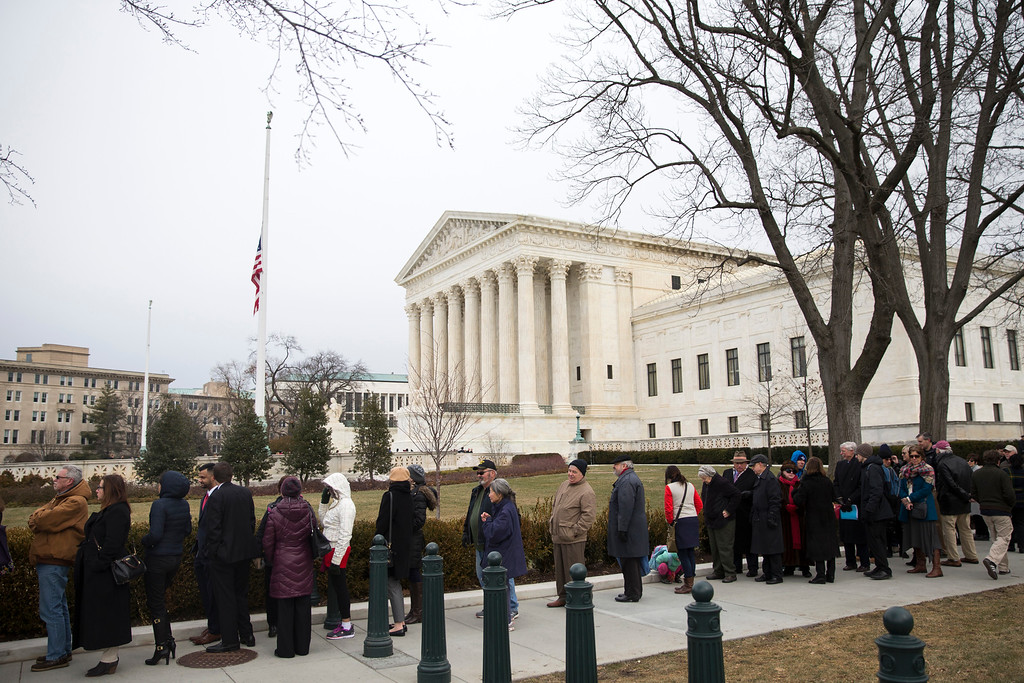 . People wait in line outside the Supreme Court in Washington, Friday, Feb. 19, 2016, to pay their respects to Justice Antonin Scalia who is lying in repose in the Great Hall. (AP Photo/Evan Vucci)