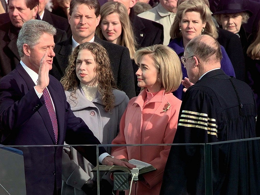 . Supreme Court Chief Justice William Rehnquist administers the presidential oath to President Clinton as first lady Hillary Rodham Clinton and daughter Chelsea look on, Monday Jan. 20, 1997 on Capitol Hill. Vice President and Mrs. Gore look on behind the first family. (AP Photo/Doug Mills)