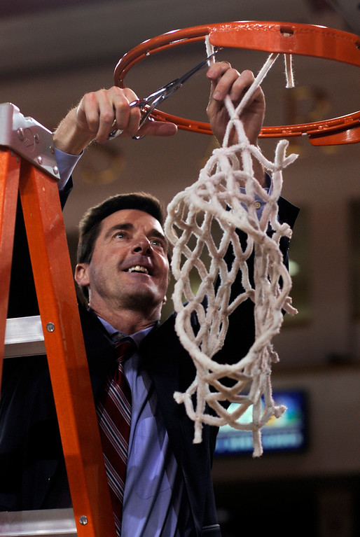 . Denver coach Joe Scott cut down the net after the win Saturday night. The University of Denver men\'s basketball team defeated the Louisiana Tech Bulldogs 78-54 at Magness Arena Saturday night, March 9, 2013. (Photo By Karl Gehring/The Denver Post)