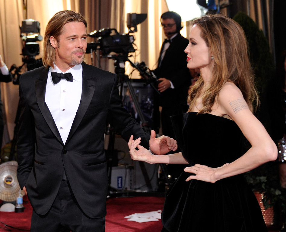. HOLLYWOOD, CA - FEBRUARY 26:  Actor Brad Pitt (L) and actress Angelina Jolie arrive at the 84th Annual Academy Awards at the Hollywood & Highland Center February 26, 2012 in Hollywood, California.  (Photo by Ethan Miller/Getty Images)