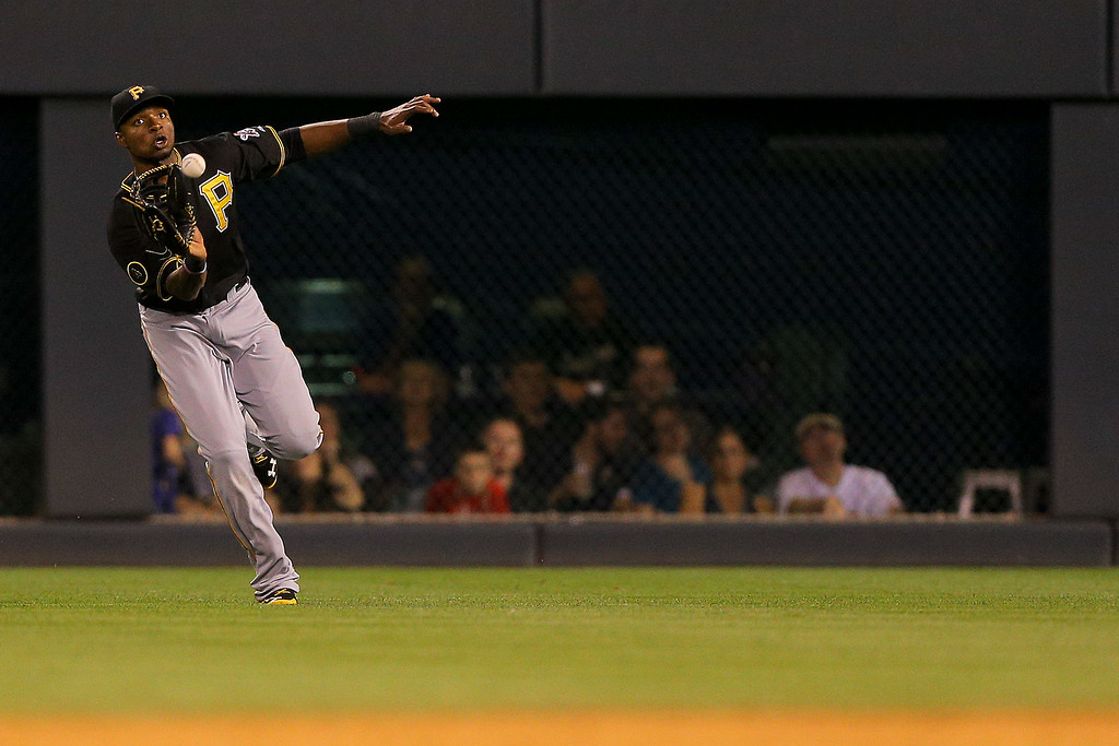 . Right fielder Gregory Polanco #25 of the Pittsburgh Pirates makes a catch on the run for the first out of the seventh inning against the Colorado Rockies at Coors Field on July 25, 2014 in Denver, Colorado. (Photo by Justin Edmonds/Getty Images)