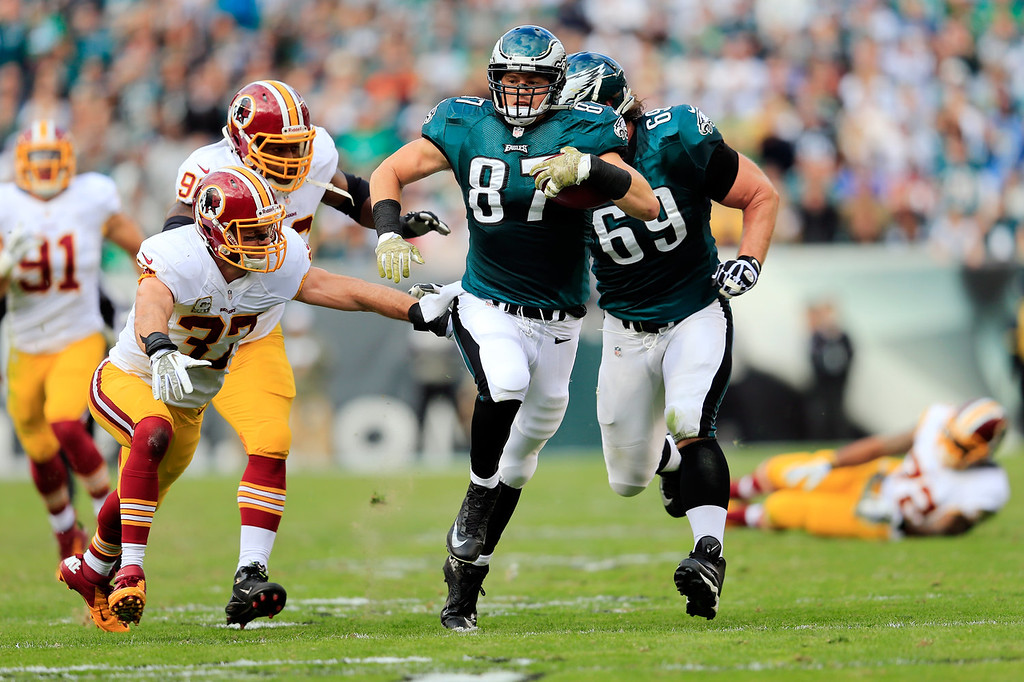. Strong safety Reed Doughty #37 of the Washington Redskins tackles tight end Brent Celek #87 of the Philadelphia Eagles after catching a second quarter pass at Lincoln Financial Field on November 17, 2013 in Philadelphia, Pennsylvania.  (Photo by Rob Carr/Getty Images)