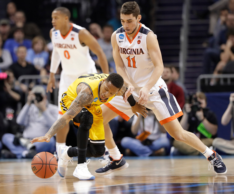 . UMBC\'s Jairus Lyles (10) loses the ball as Virginia\'s Ty Jerome (11) defends during the first half of a first-round game in the NCAA men\'s college basketball tournament in Charlotte, N.C., Friday, March 16, 2018. (AP Photo/Gerry Broome)