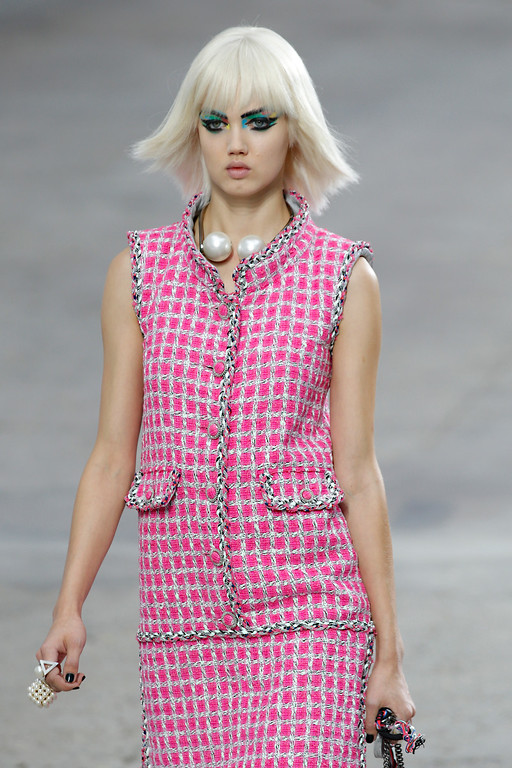 . A model presents a creation as part of Chanel\'s ready-to-wear Spring/Summer 2014 fashion collection, presented Tuesday, Oct. 1, 2013 in Paris. (AP Photo/Christophe Ena)