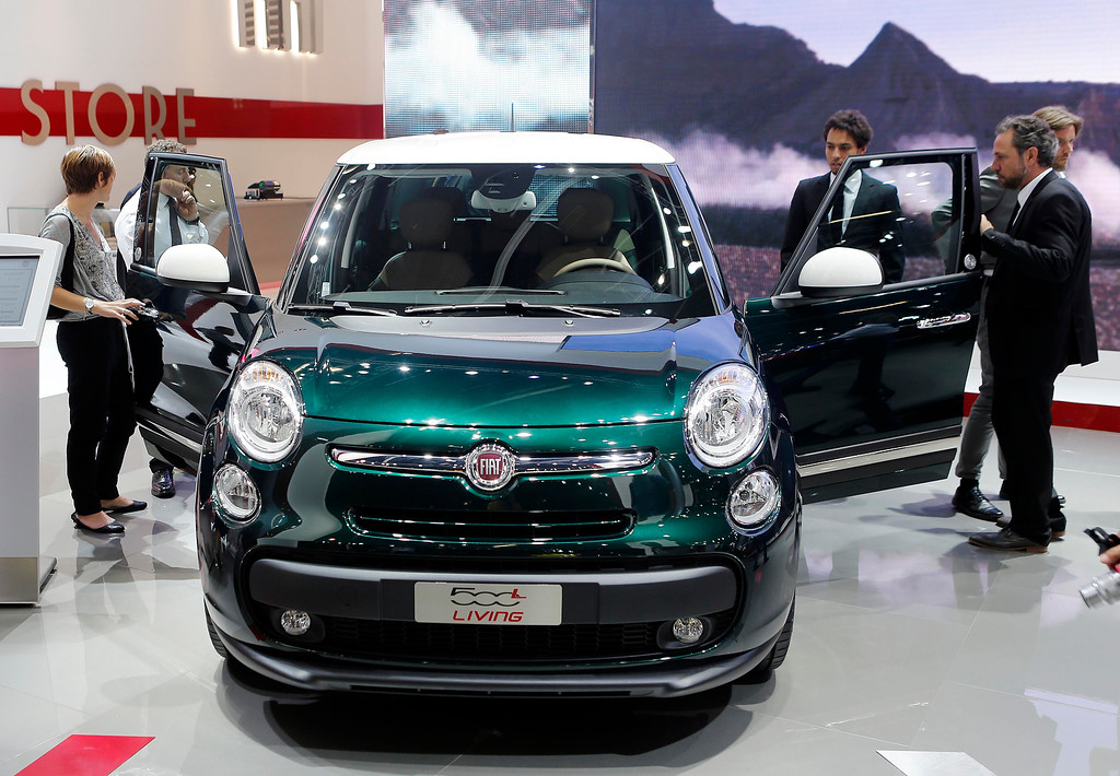 . Visitors take a look a the Fiat 500 Living during the first press day of the 65th Frankfurt Auto Show in Frankfurt, Germany, Tuesday, Sept. 10, 2013.  (AP Photo/Michael Probst)