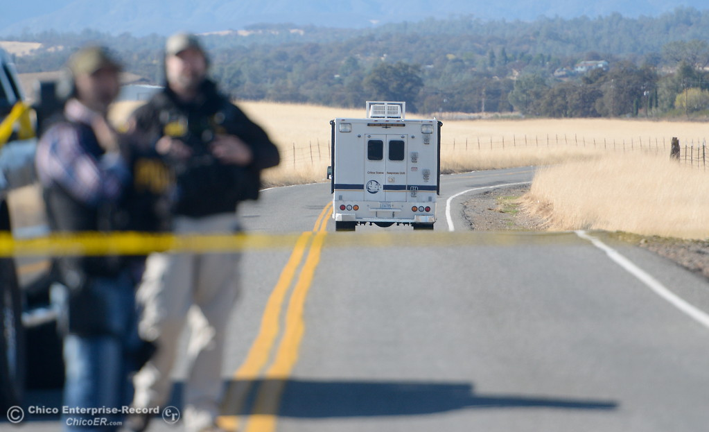 . A California Department of Justice vehicle heads to the scene along Rancho Tehama Road following multiple shootings in the community of Rancho Tehama Tues. Nov. 14, 2017.  (Bill Husa -- Enterprise-Record)