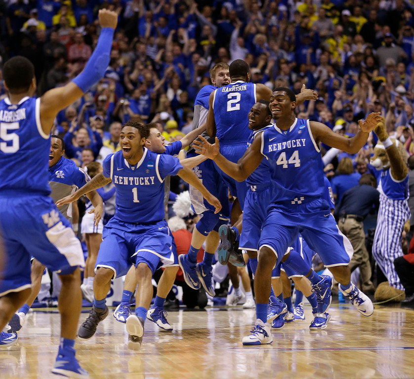 . Kentucky  players celebrate after an NCAA Midwest Regional final college basketball tournament game against Michigan Sunday, March 30, 2014, in Indianapolis. Kentucky won 75-72 to advance to the Final Four.(AP Photo/Michael Conroy)