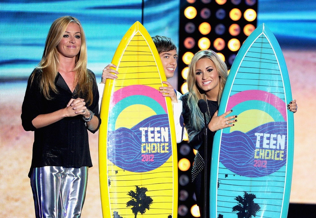 . August 11, 2013: Teen Choice Awards<br /> <br />UNIVERSAL CITY, CA - JULY 22:  TV personality Cat Deeley (L) presents hosts Kevin McHale and Demi Lovato the Host Choice award onstage during the 2012 Teen Choice Awards at Gibson Amphitheatre on July 22, 2012 in Universal City, California.  (Photo by Kevin Winter/Getty Images)