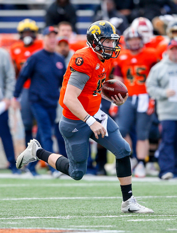 . North squad quarterback C.J. Beathard of Iowa (15) scrambles for a first down against the South squad during the first half of the Senior Bowl NCAA college football game, Saturday, Jan. 28, 2017, at Ladd-Peebles Stadium in Mobile, Ala. (AP Photo/Butch Dill)