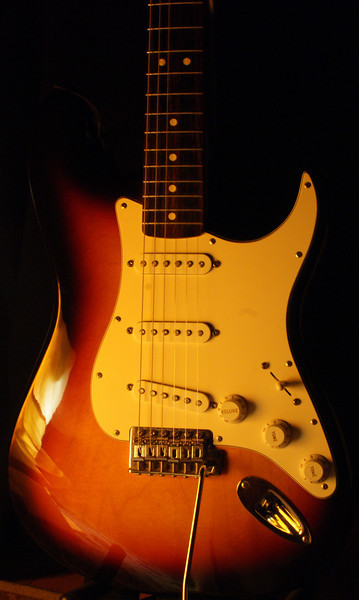 Sunburst Strat: I thought that the white light was a bit too harsh, so I drapped a yellow shirt over the light. I think I may need to update my lighting set up