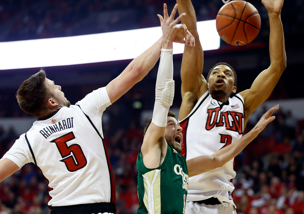 . UNLV\'s Katin Reinhardt, left, and Khem Birch, right, try to block a shot from Colorado State\'s Wes Eikmeier during the first half of an NCAA college basketball game Wednesday, Feb. 20, 2013, in Las Vegas. (AP Photo/Isaac Brekken)