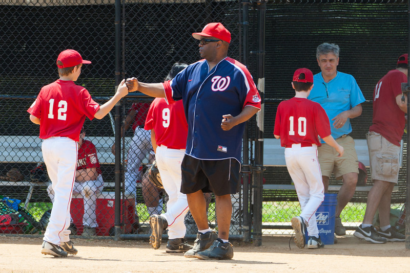 Coach Coop enjoying some excellent defensive plays as the Nats head into the 5th inning leading 6-4. The bats of the Nationals were supported by a great defensive outing in a 11-4 win over the Twins. They are now 7-3 for the season. 2012 Arlington Little League Baseball, Majors Division. Nationals vs Twins (13 May 2012) (Image taken by Patrick R. Kane on 13 May 2012 with Canon EOS-1D Mark III at ISO 400, f4.0, 1/1250 sec and 192mm)