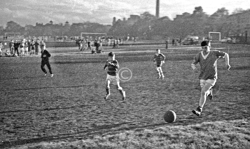 BB football at the Queen's Park Recs, on the junior pitch which ran parallel to Queen's Drive, behind the prefabs.   Cruising down the wing is Davie Buchan of the 113th, the company I was in. Neither my camera nor my technique were quite up to action shots at this time. c1963