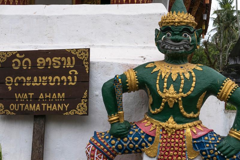 Guardian statue outside temple, Wat Aham, Luang Prabang, Laos