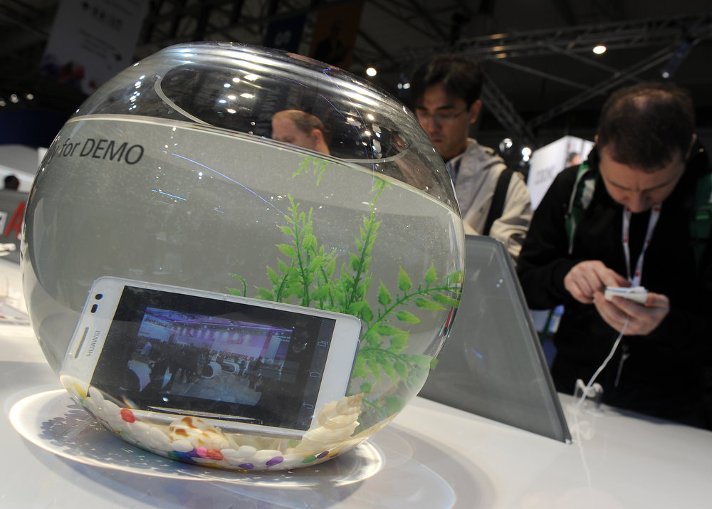 . A Huawei\'s Ascend D2 smartphone in a fishbowl at the 2013 Mobile World Congress in Barcelona on February 25, 2013. The 2013 Mobile World Congress, the world\'s biggest mobile fair, is held from February 25 to 28 in Barcelona.  LLUIS GENE/AFP/Getty Images