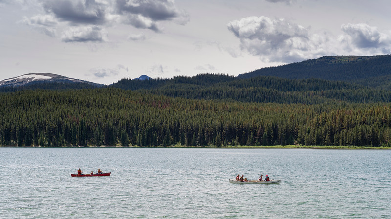 Tourists boating in Malign Lake, Maligne Canyon, Jasper National Park, Jasper, Alberta, Canada