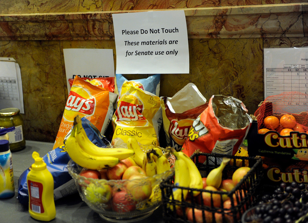 . DENVER, CO. - MARCH 8: A desk outside the Senate chambers usually reserved for official paperwork was used for snacks as the Colorado Senate continued to debate various gun control measures Friday night, March 8, 2013. (Photo By Karl Gehring/The Denver Post)
