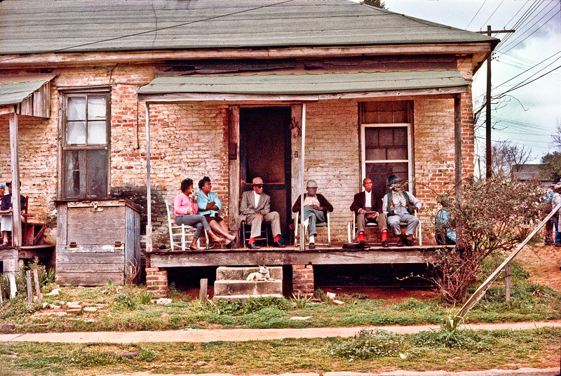 Selma To Montgomery Civil Rights March, March 25, 1965: Six Negro (African-American) adults on old dilapidated porch