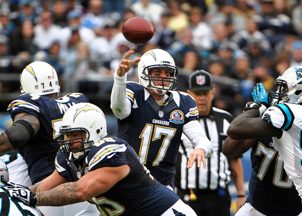 Description of . San Diego Chargers quarterback Philip Rivers throws a pass against the Carolina Panthers during the first half of a NFL football game Sunday, Dec. 16, 2012, in San Diego. (AP Photo/Denis Poroy)