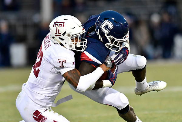 11/24/2018 Mike Orazzi | Staff UConn's Kevin Mensah (34) and Temple's Benny Walls III (32) during Saturday's football game at Rentschler Field in East Hartford.