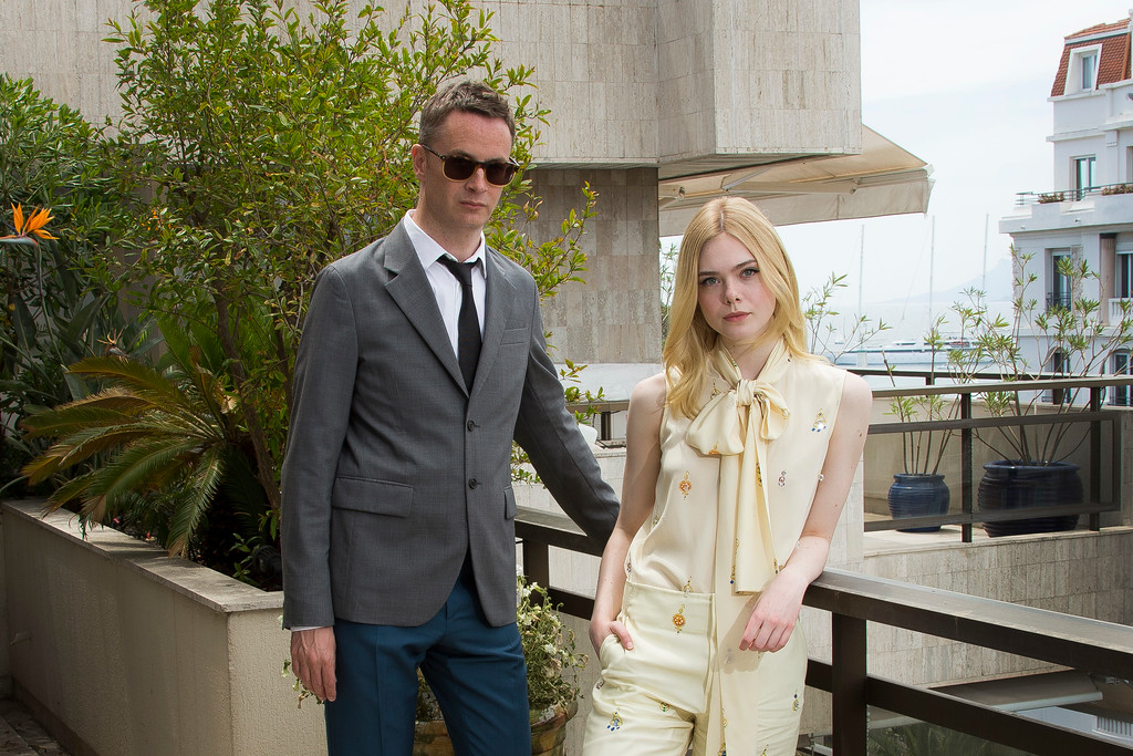 . Nicolas Winding Refn and Elle Fanning pose for portrait photographs for the film Neon Demon, at the 69th international film festival, Cannes, southern France, Sunday, May 22, 2016. (AP Photo/Joel Ryan)