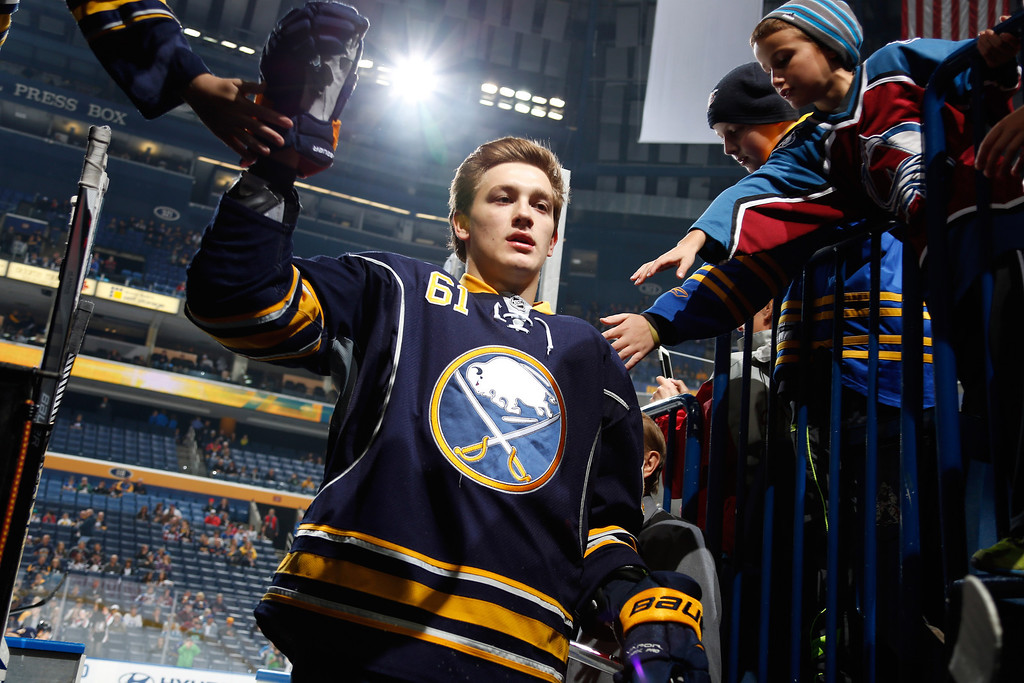 . BUFFALO, NY - OCTOBER 19: Nikita Zadorov #61 of the Buffalo Sabres heads to the locker room before his first NHL game after warming up to play the Colorado Avalanche at First Niagara Center on October 19, 2013 in Buffalo, New York.  (Photo by Jen Fuller/Getty Images)
