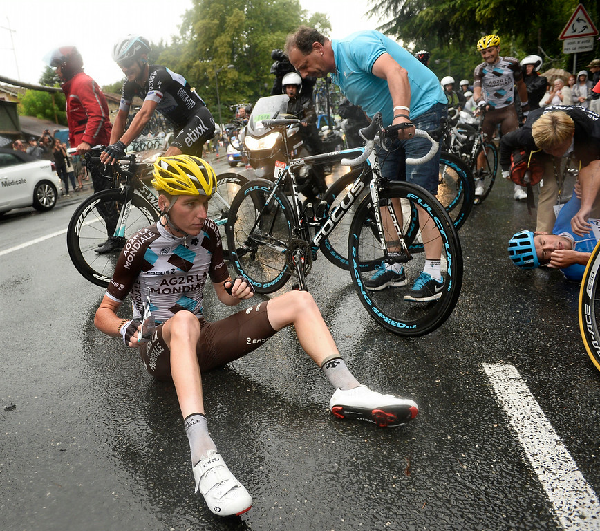 . New Zealand\'s Jack Bauer, right, and France\'s Romain Bardet left, wait for assistance after crashing in the last three kilometers of the nineteenth stage of the Tour de France cycling race over 208.5 kilometers (129.6 miles) with start in Maubourguet and finish in Bergerac, France, Friday, July 25, 2014. (AP Photo/Lionel Bonaventure, Pool)