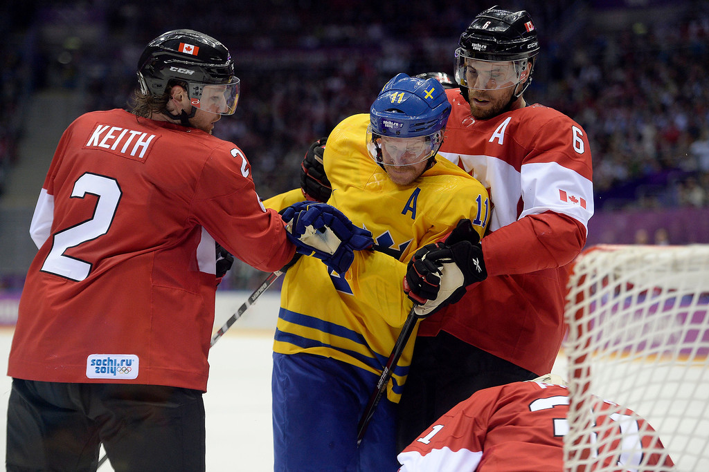. Duncan Keith (2) of Canada and Shea Weber (6) get physical with Daniel Alfredsson (11) of Sweden near the crease during the second period of the men\'s ice hockey gold medal game. Sochi 2014 Winter Olympics on Sunday, February 23, 2014 at Bolshoy Ice Arena. (Photo by AAron Ontiveroz/ The Denver Post)
