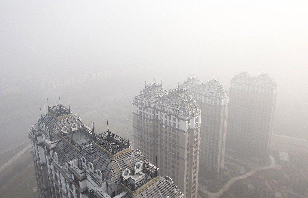 . Buildings and streets are seen under heavy smog in Harbin, northeast China\'s Heilongjiang province on October 22, 2013.   AFP PHOTOSTR/AFP/Getty Images
