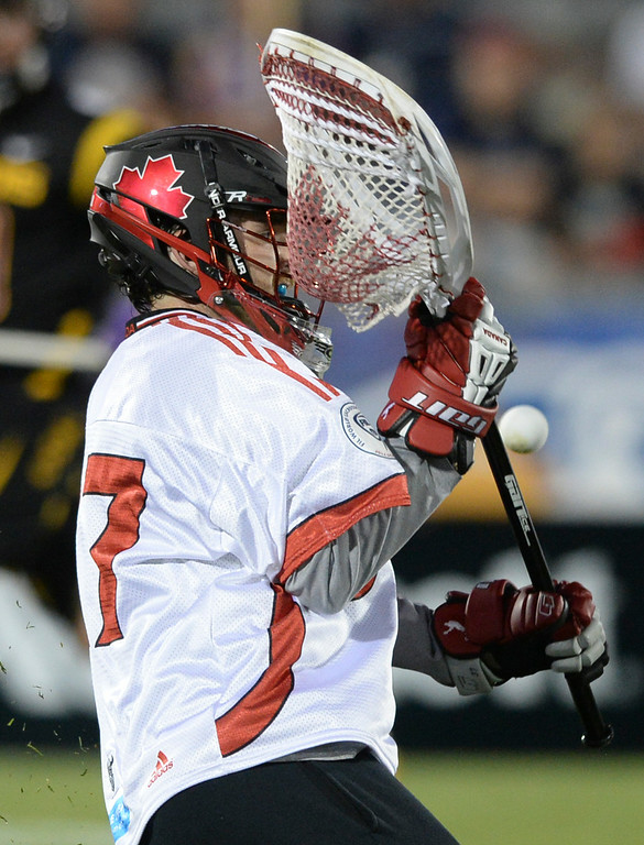 . COMMERCE CITY, CO - JULY 17: Canada goalie Dillon Ward made a save in the second half. The Iroquois Nationals took on Canada in a FIL World Championship semifinal game Thursday night, July 17, 2014.  Photo by Karl Gehring/The Denver Post