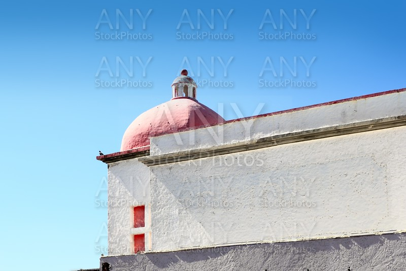 mexican white house with red dome