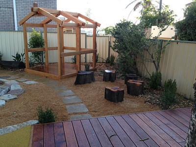 log round seating and open plan timber cubby