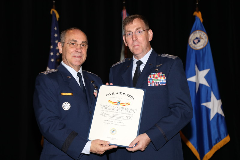 The National Commander's Commendation Award is presented to Lt Col Darin Ninness for his efforts to create a photo archive on the new CAP.news website.  Photo by Susan Schneider, CAPNHQ